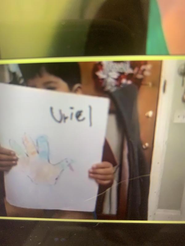 Uriel holding turkey on zoom