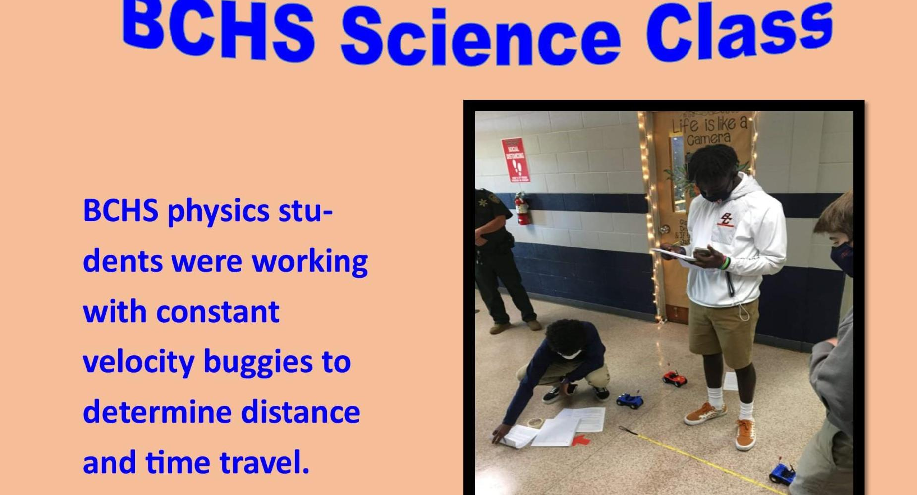 Ms. Henry's Physics students works with constant velocity buggies to determine time and distance.
