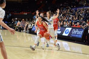 Alyson M. drives to the basket