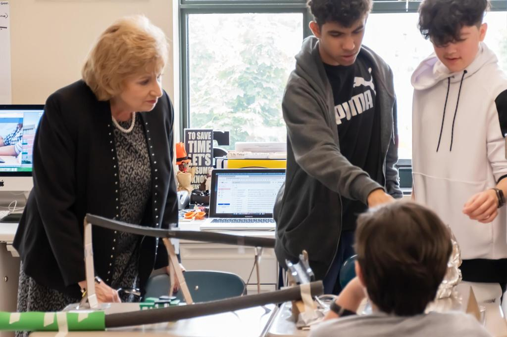 Superintendent Janice Gauthier interacts with Keverian students during the STEM open house