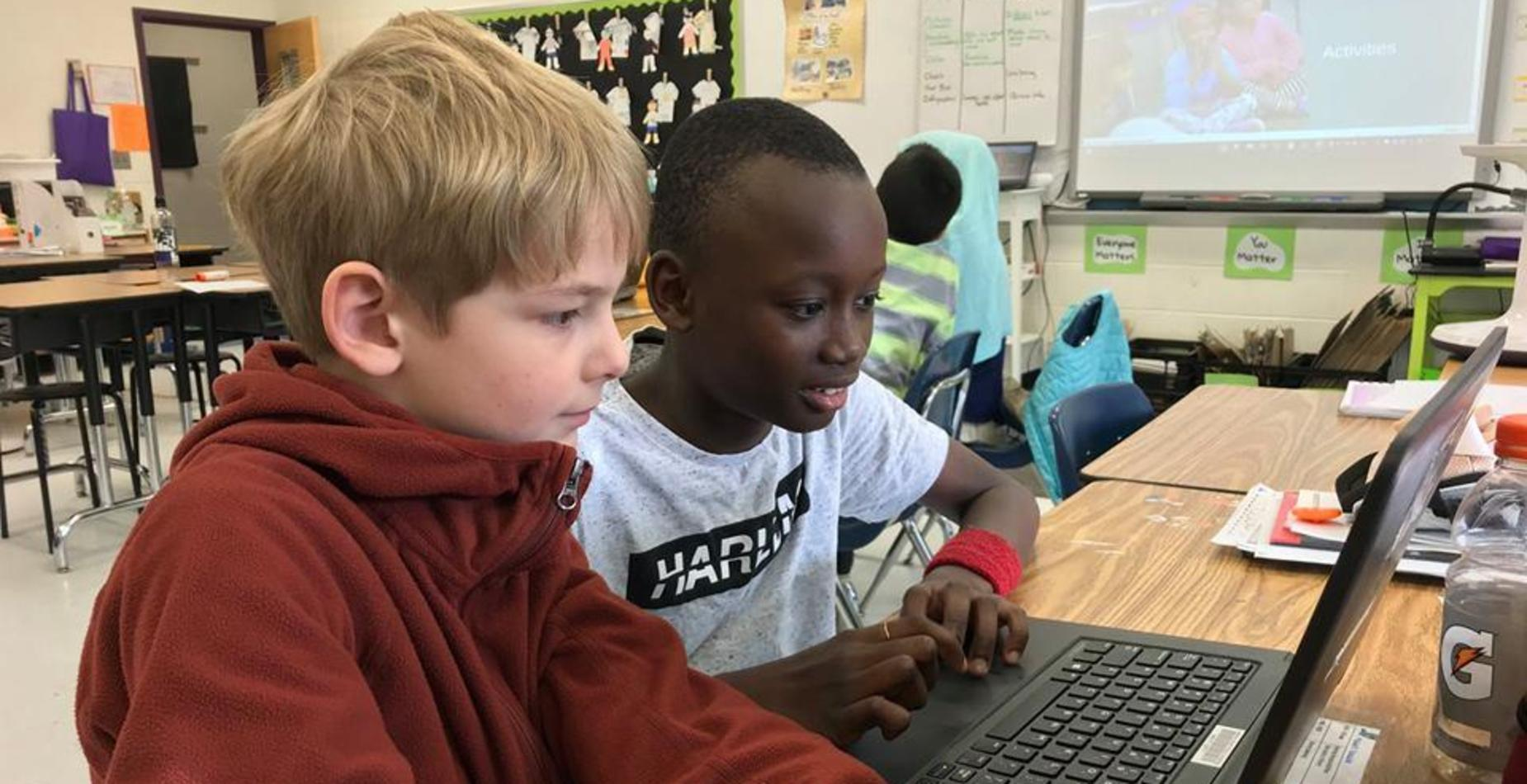photo of two boys at computer