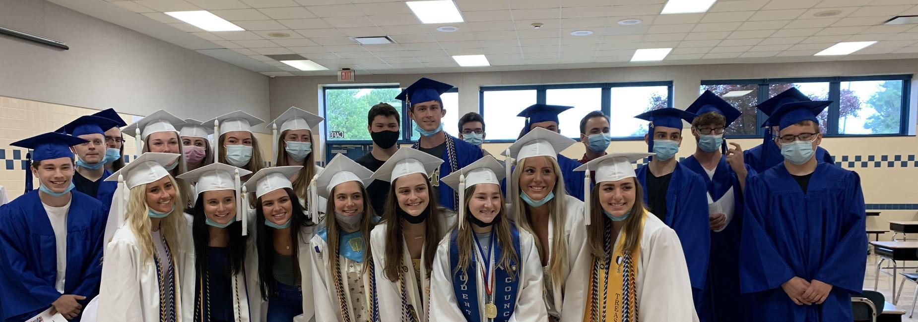 kids in graduation robes