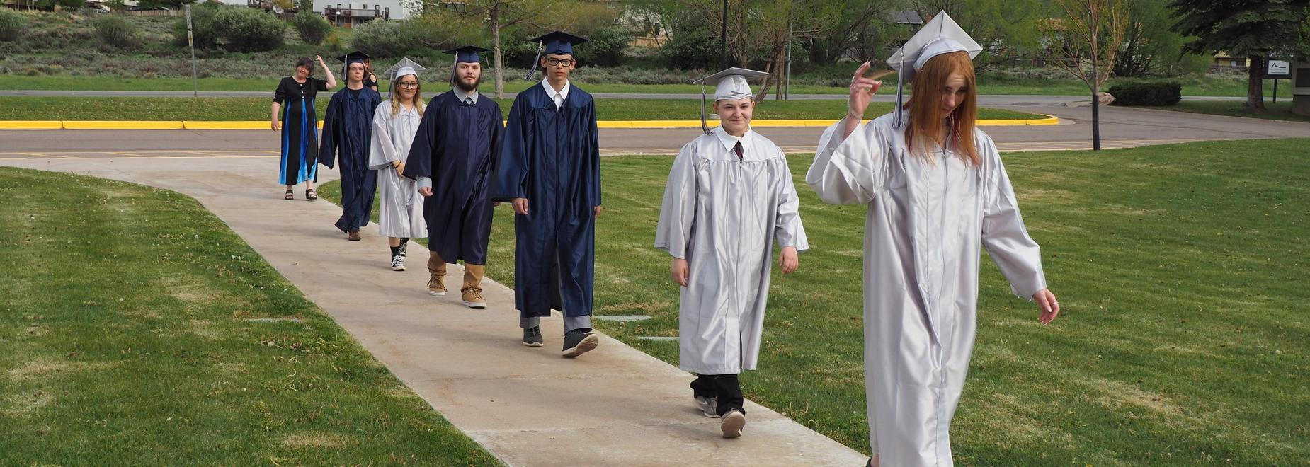 Graduates walking on Sidewalk