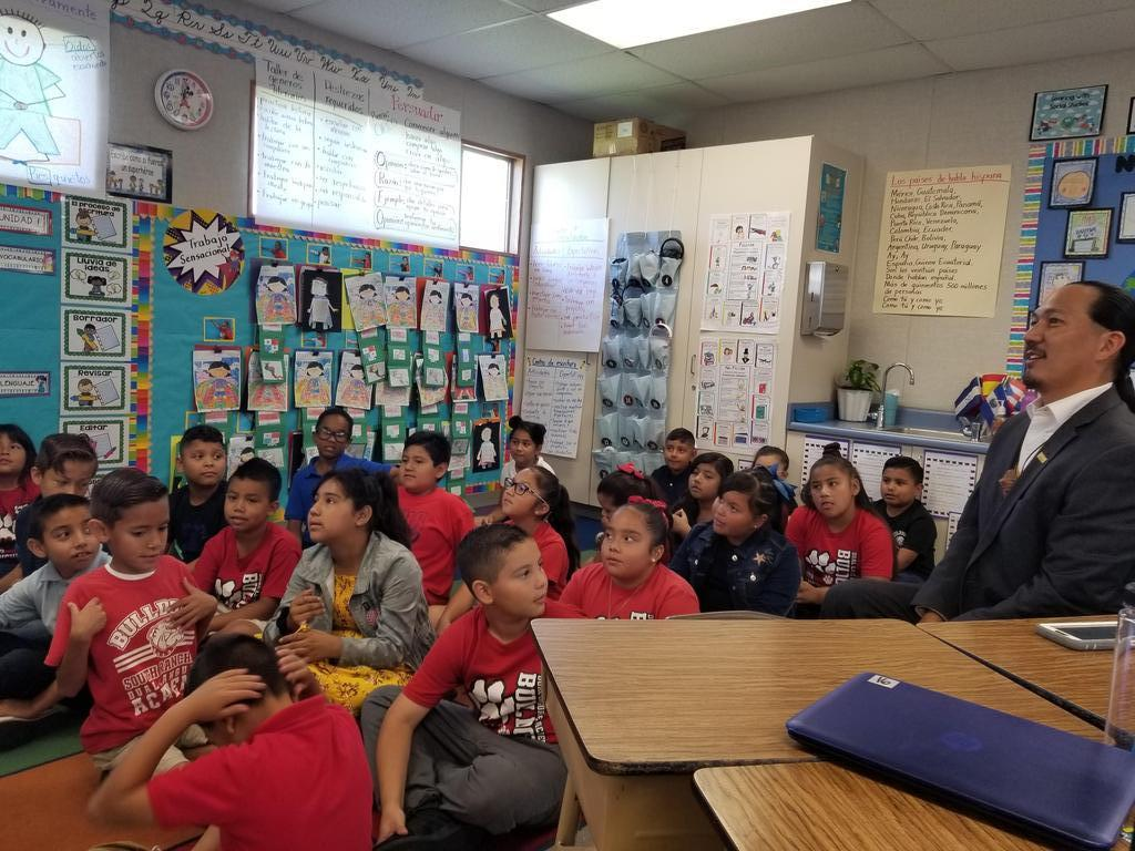 Board Member Orozco participating in a dual language class.