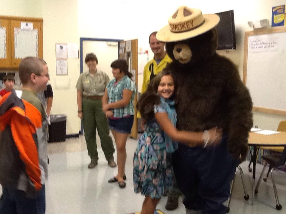 Student hugging Smokey the Bear