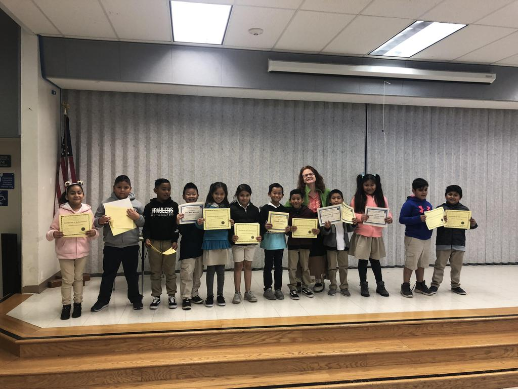 trimester one award winners in Ms. Knezevich's class pose for picture