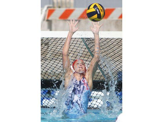 Women's Waterpolo CIF game, the goalie blocking