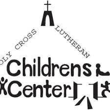 A triangle with the words Holy Cross Lutheran Children's Center