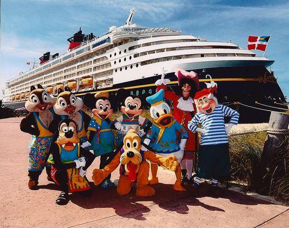 Disney characters in front of a cruise ship