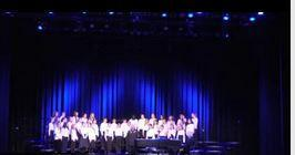 a picture of the chorus performing at NPAC