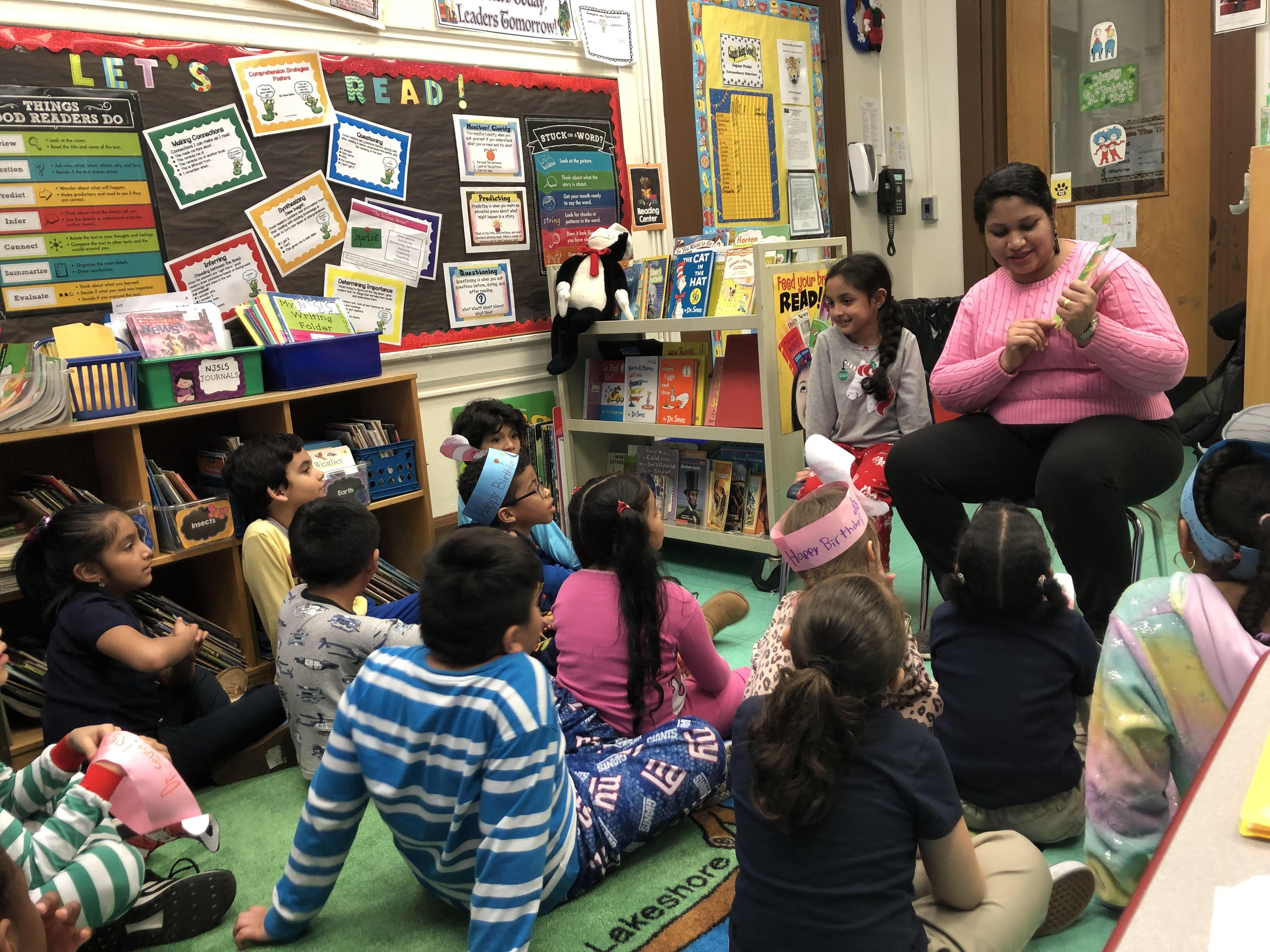 MOther reading to her daughter's class