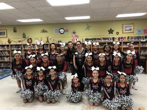 cheer team with board member