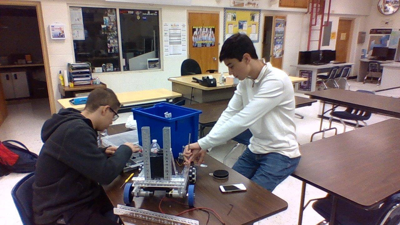 two students working on robotics project