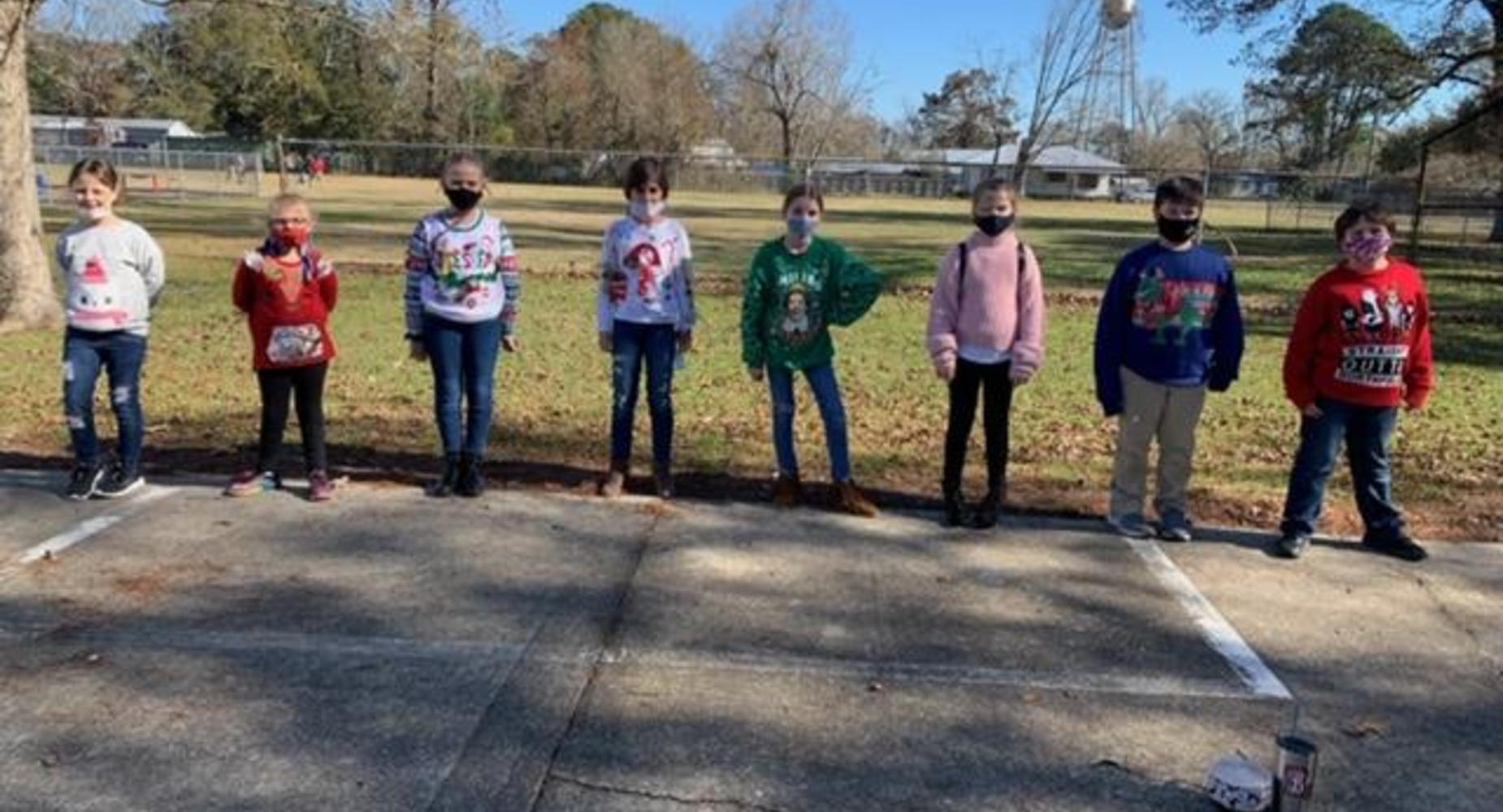 4th grade students in ugly Christmas Sweaters