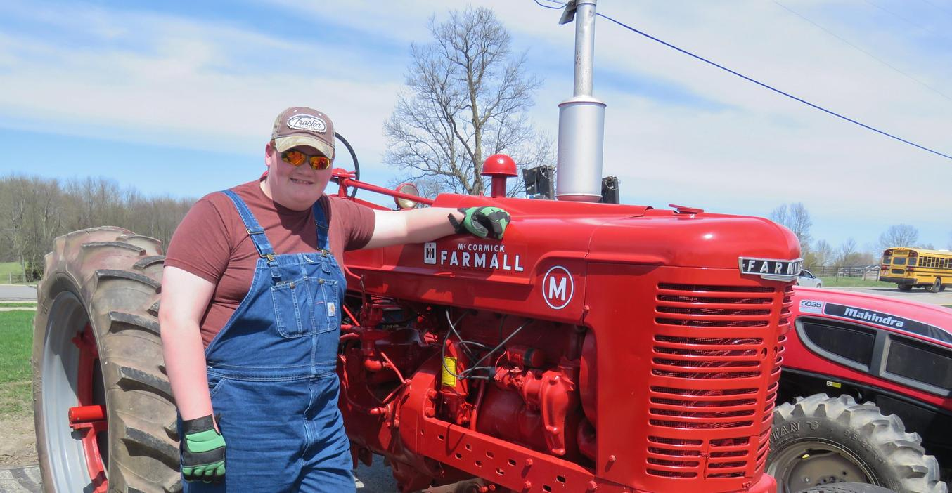 TKHS students drive their tractors to school in the annual Farmer Day celebration.