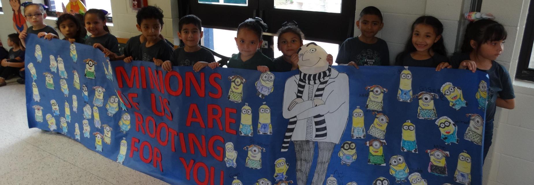 Kinder holding STAAR poster