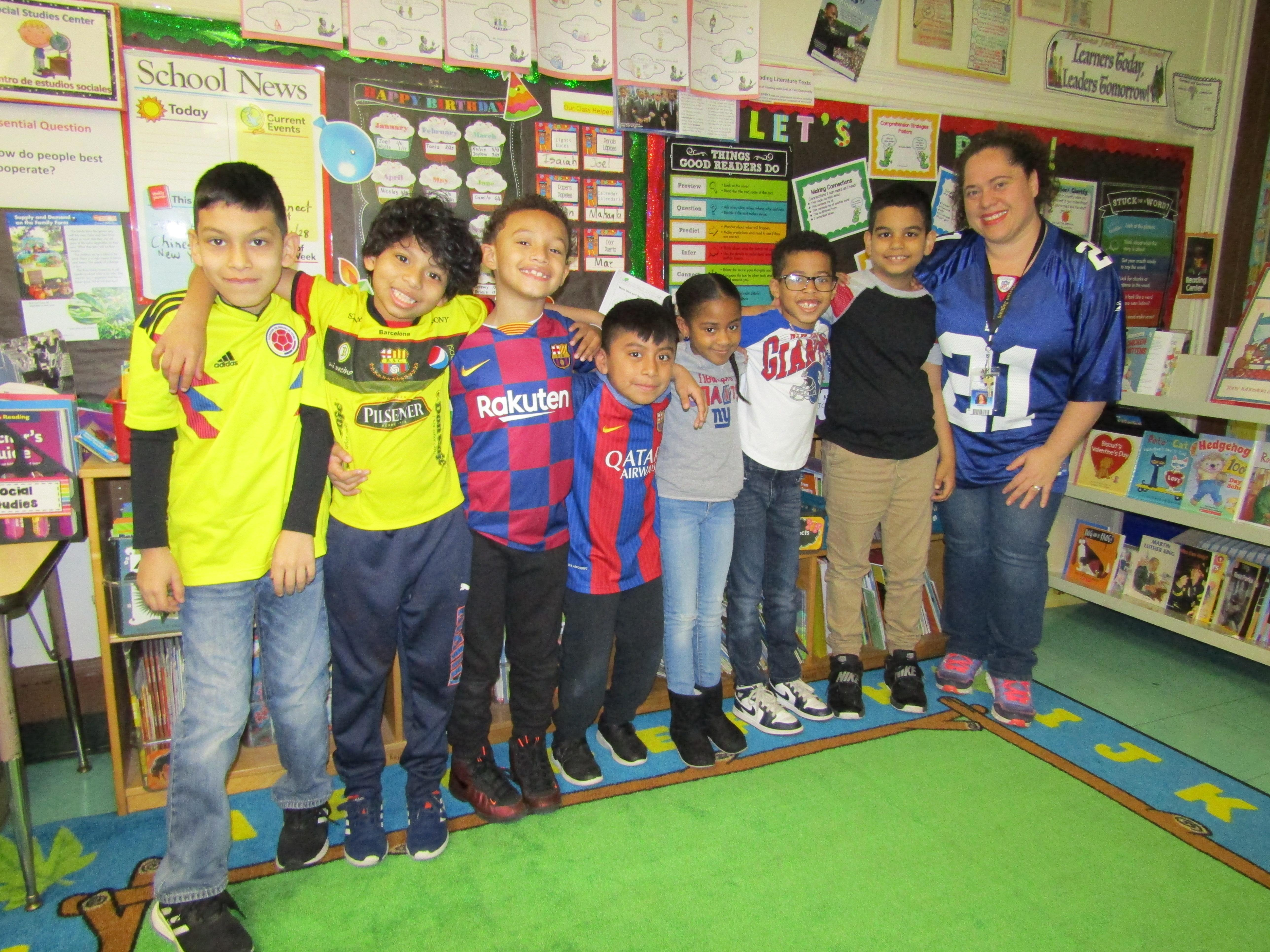 teacher with her students who are wearing sports jerseys