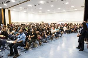 Full gym of parents and students at Back to School Night