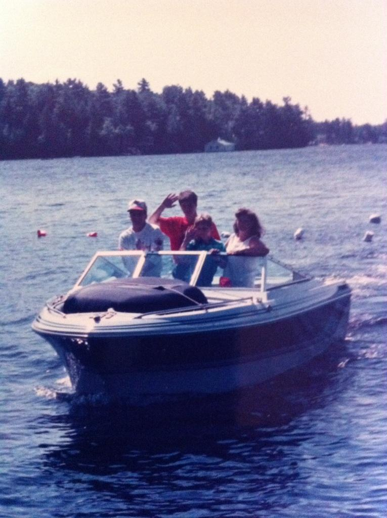 Mrs. Powell with her family on a boat.