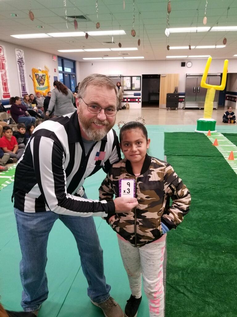 Mr. Gregerson and a student at the math super bowl