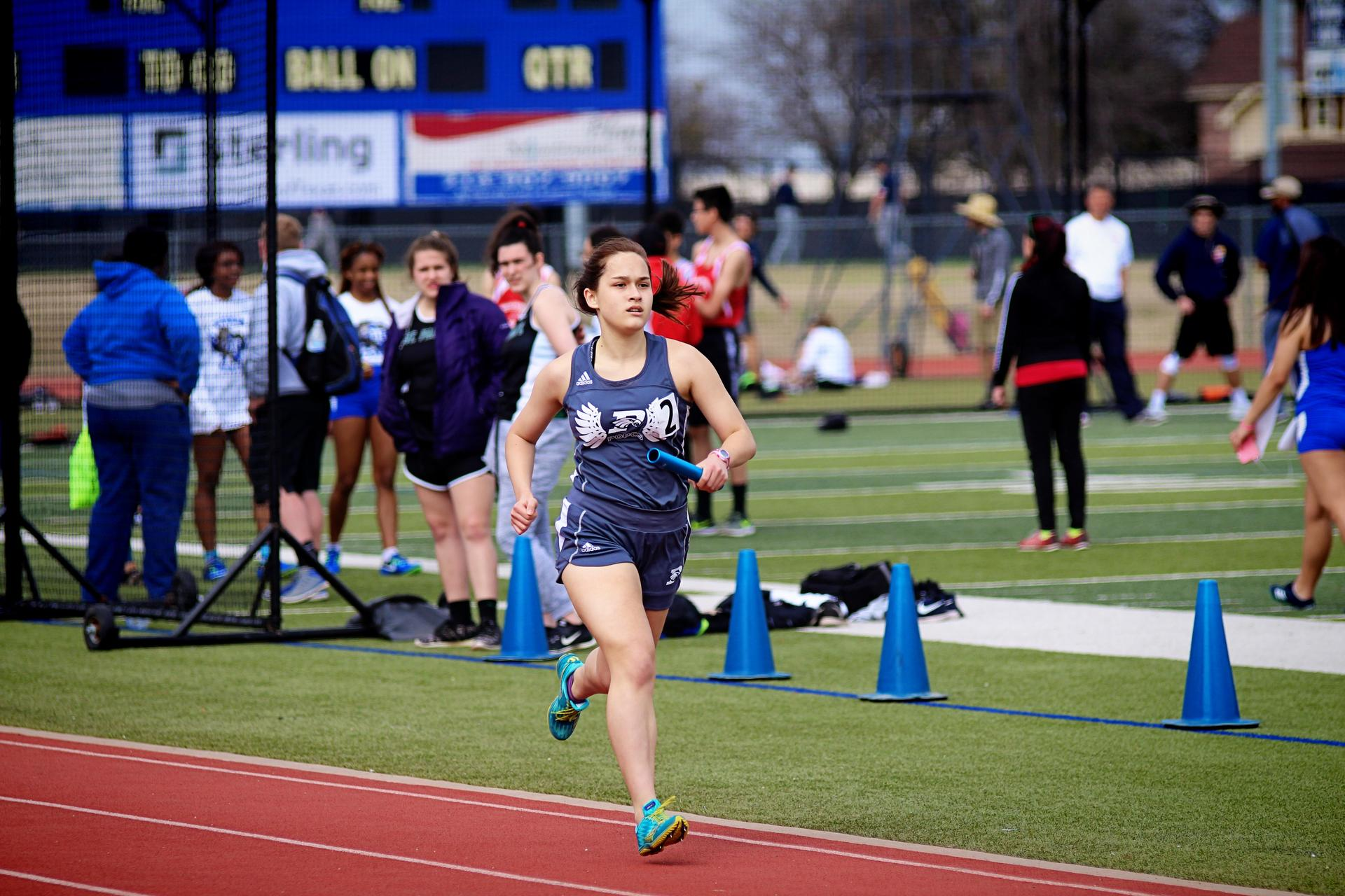 Girl running in track meet