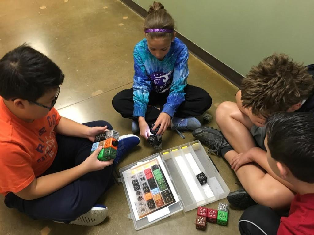 Sixth graders are challenged to program a Cubelet robot as a team.