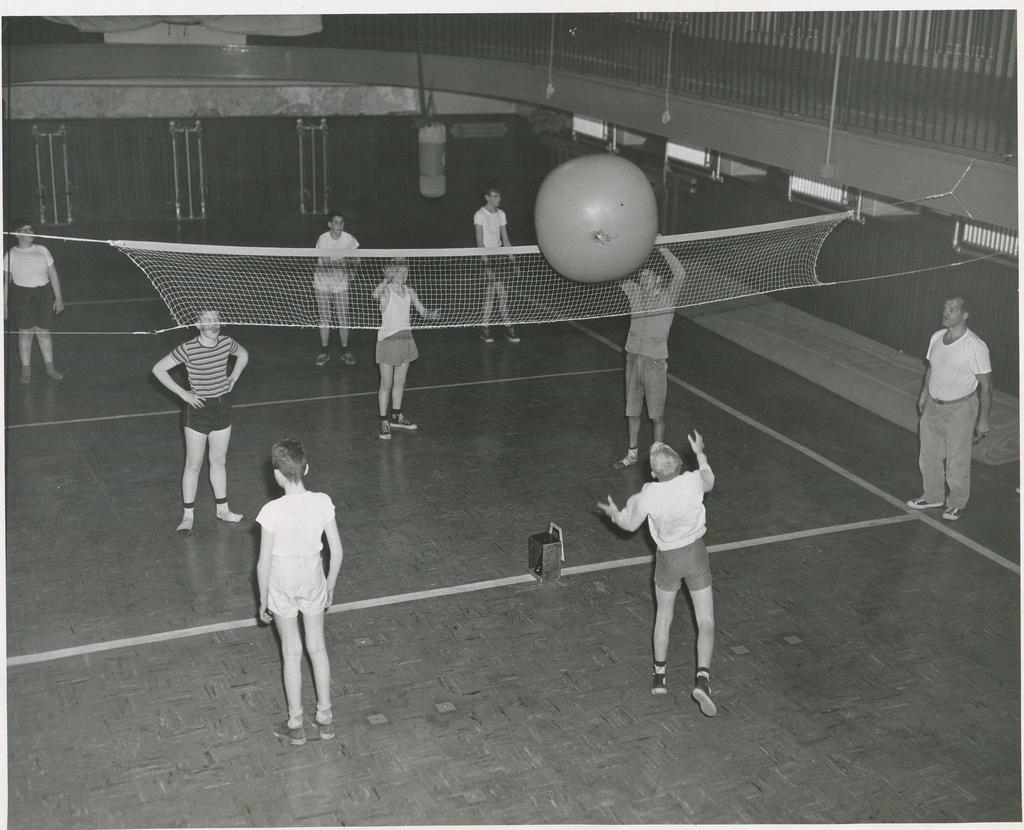 Student playing volleyball using a massive 3 foot ball.