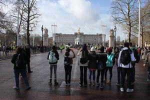 students taking pictures of Buckingham Palace