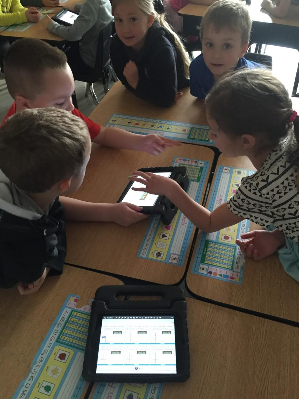1st Graders collaborating with technology