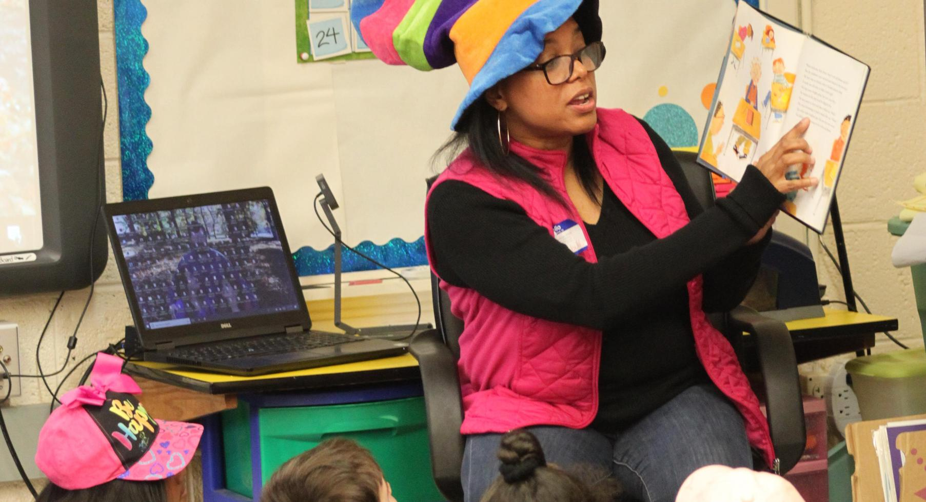 Angela Campbell reads to students