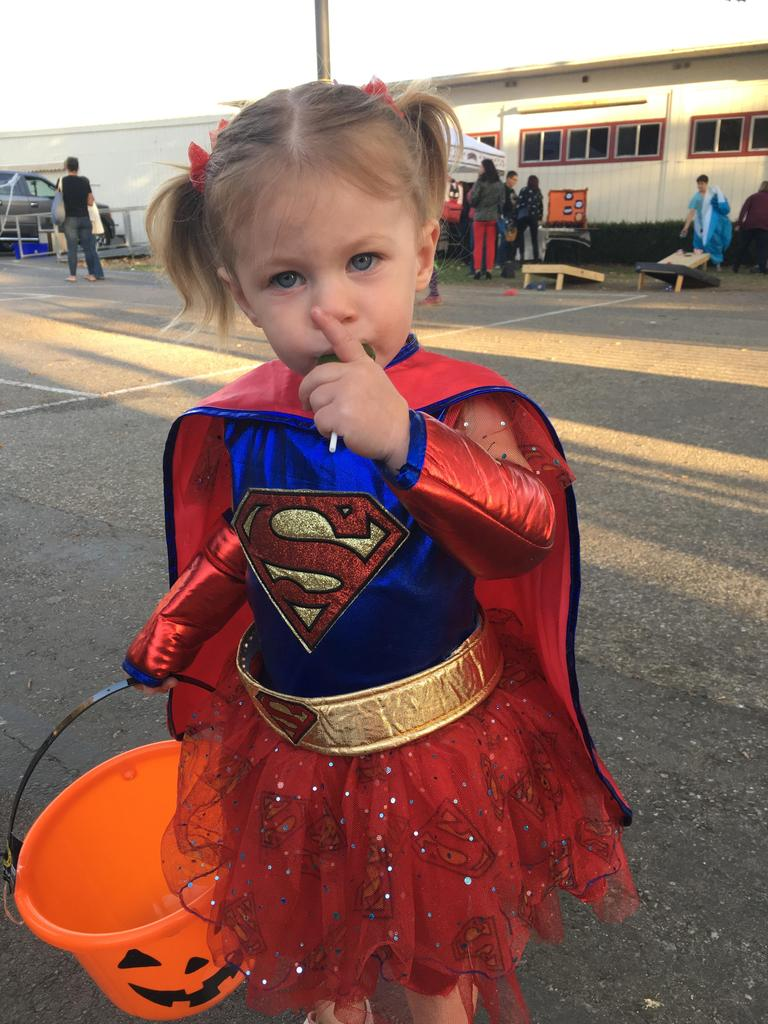 child dressed as super girl