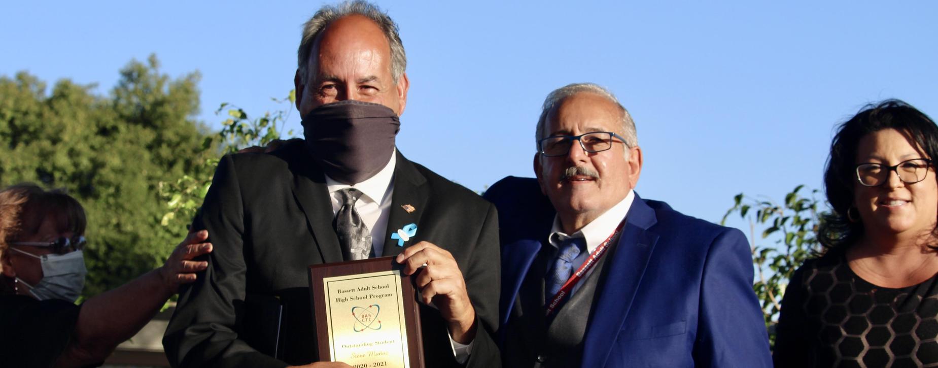 Mr. Munoz accepting Teacher of the Year award