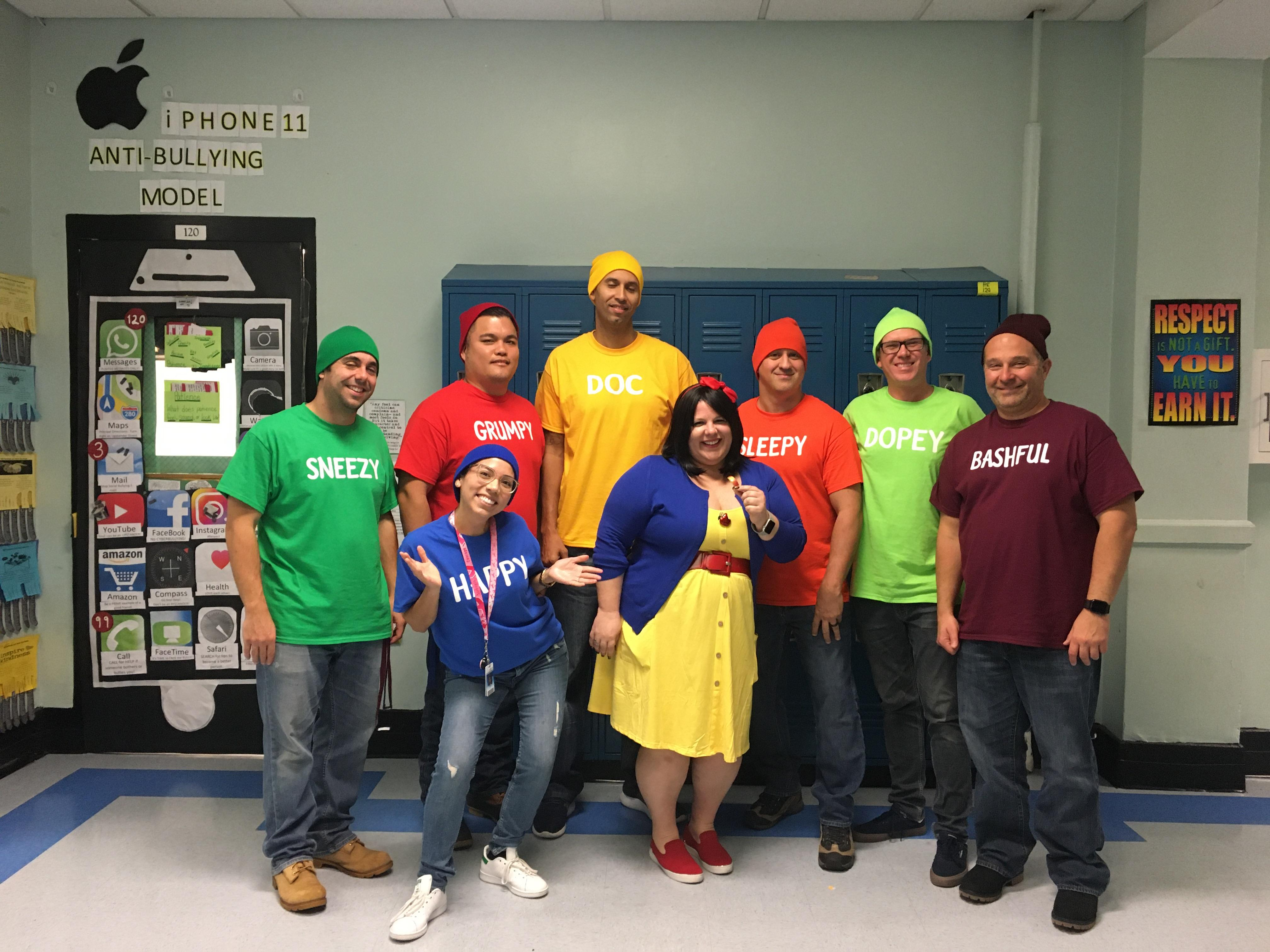 group of teachers dressed as snow white and her dwarfs