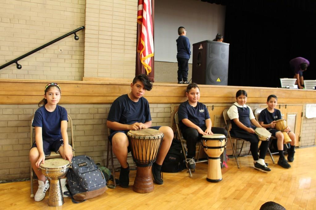 5 students sitting at their drums