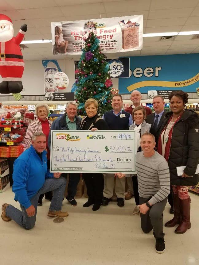 A check is presented for Race Against Hunger