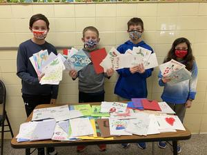 Student Council Officers hold up holiday cards