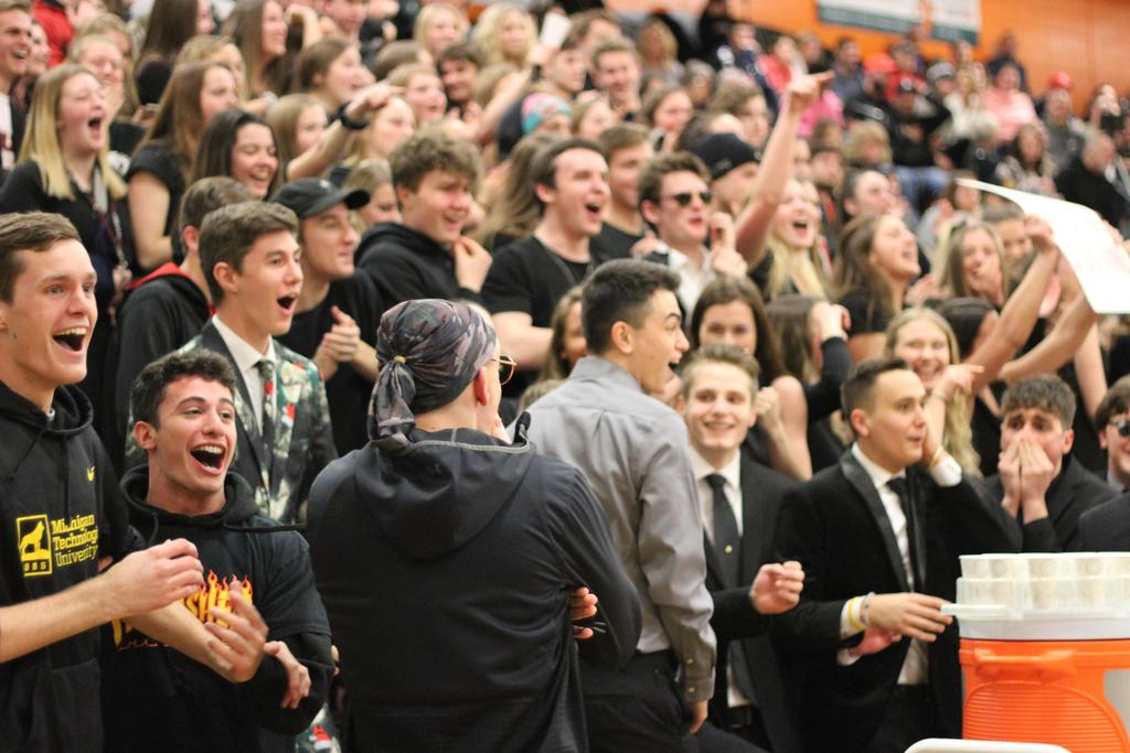 A cheering crowd of basketball spectators