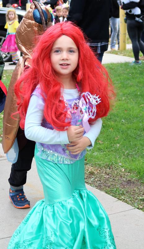 The Little Mermaid is one of the costumes worn during the Lincoln School Halloween Parade.