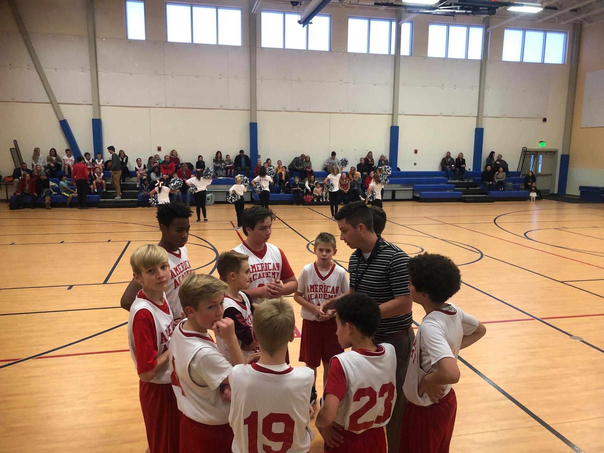 Motsenbocker boys basketball huddle with coach