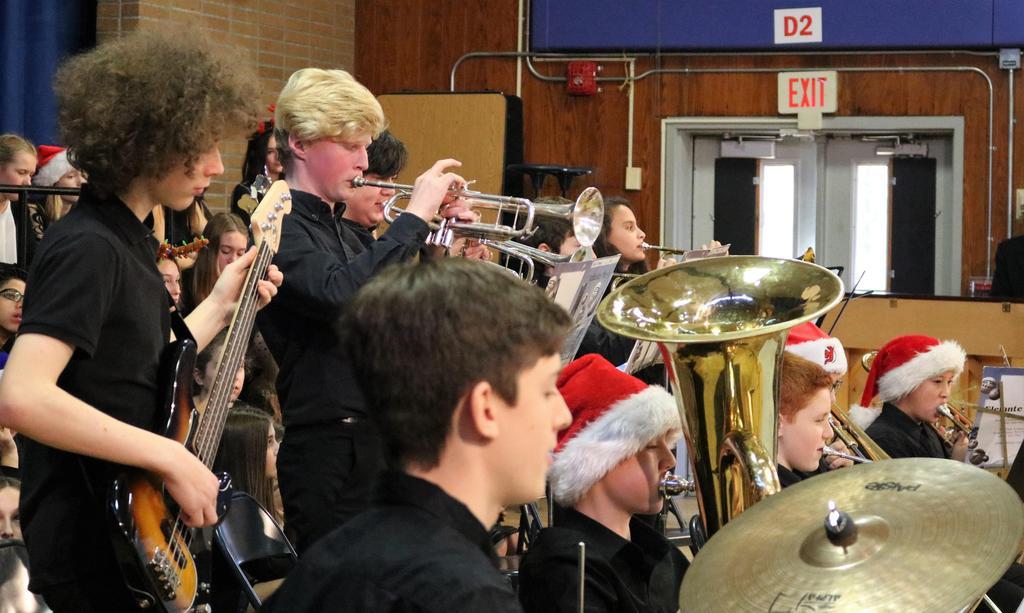 Photo of Roosevelt Jazz Band performing for Washington School students.