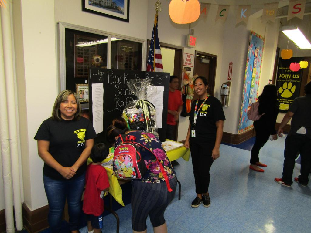 Volunteers at the Back to School Night Rafle Table