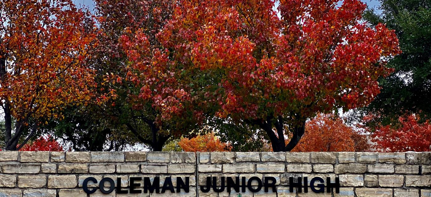 Coleman Junior High outdoor sign with colorful fall leaves