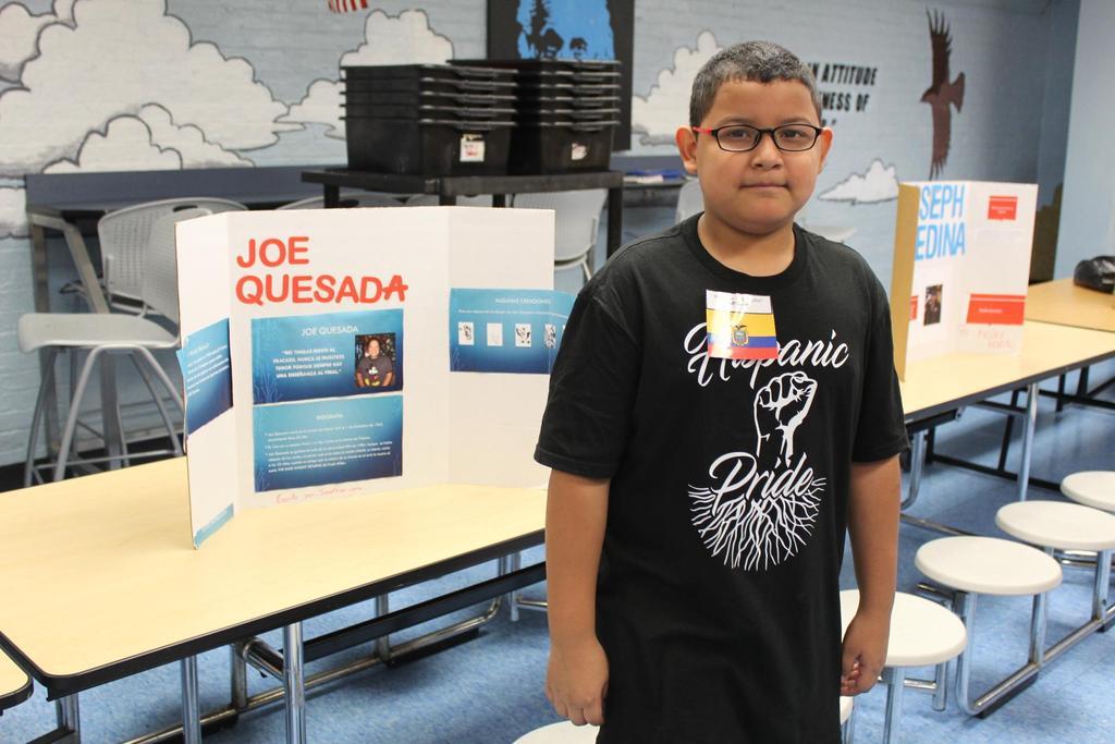 boy with presentation about joe quesada