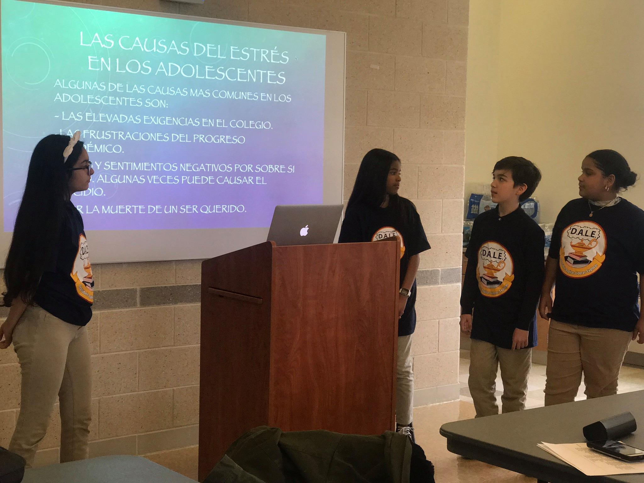 four kids wearing DALE T-shirt presenting a adolescents and stress presentations