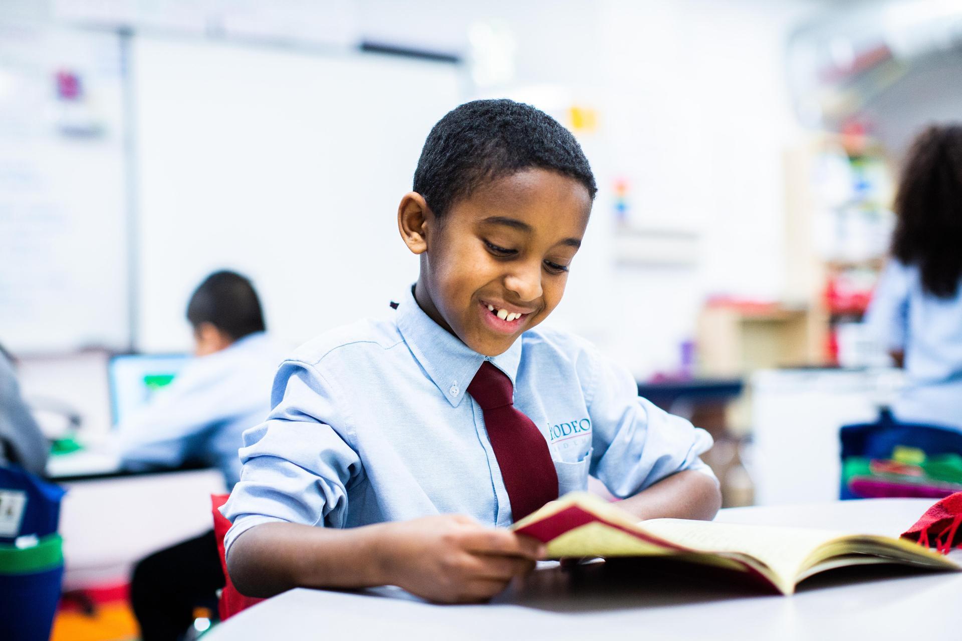 scholar reading a book