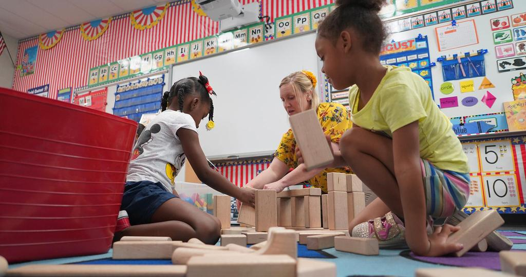 Two students building blocks