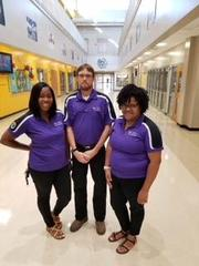 Mrs. Guinyard, Mr. Wilkes, and Mrs. Weston (some of the newer teachers) smiling for the camera.