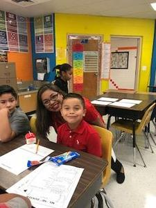 Mrs. Cruz with her students.