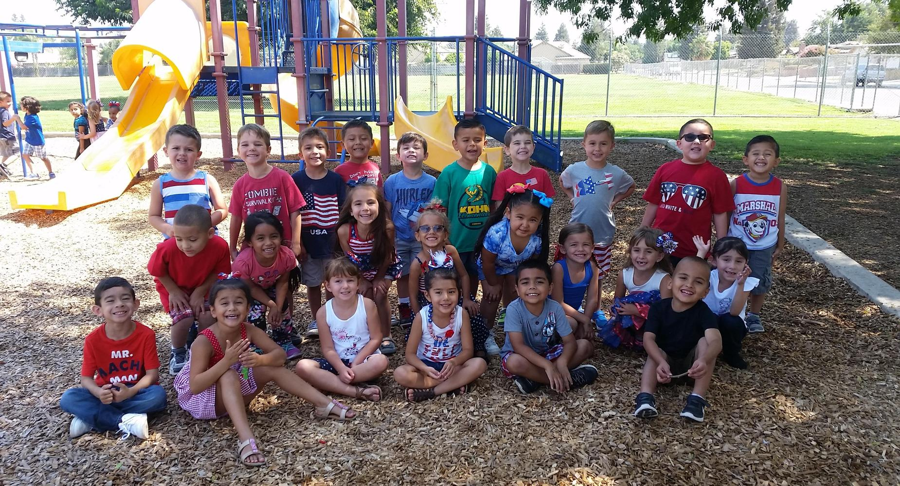 TK class posing by playground equipment.