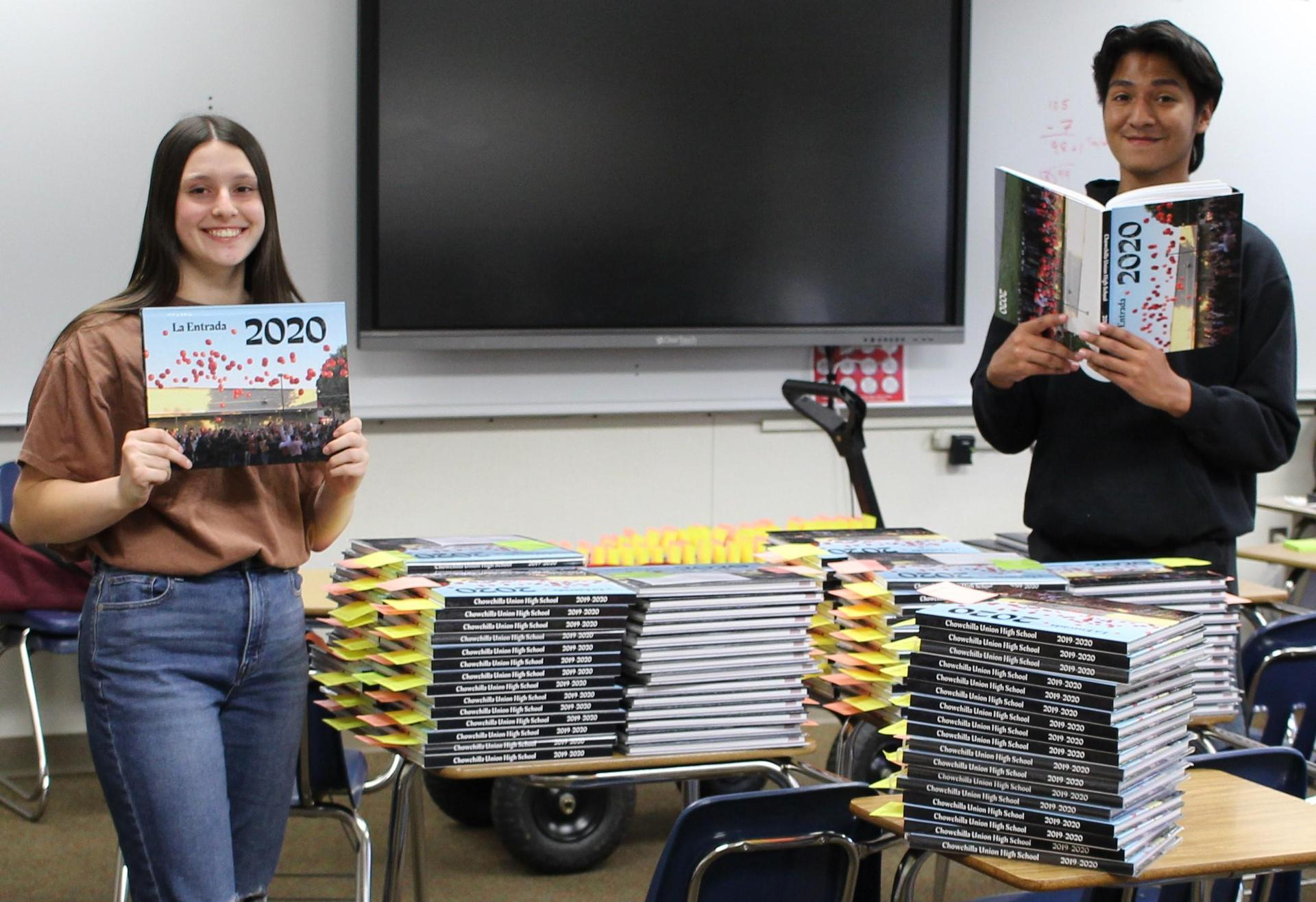 Grace Sheppard and Luis Guevara pose with the 2020 Yearbook